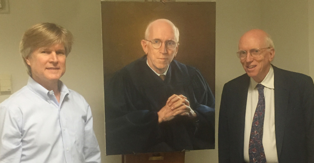 Artist Steve Craighead and Judge Smith pose with the finished portrait